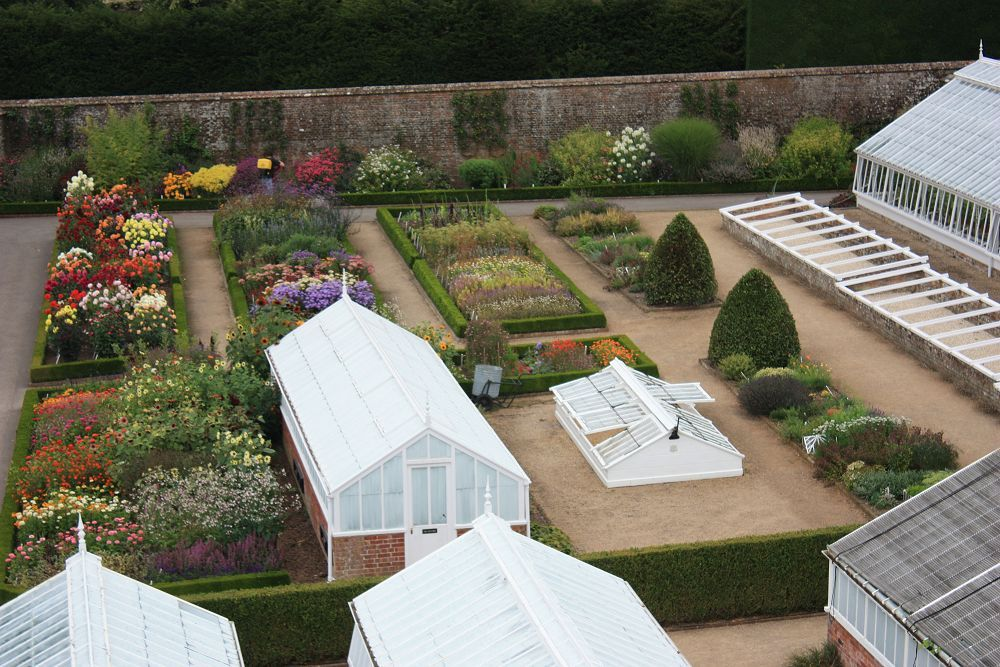 Victorian Glasshouses in the walled garden at West Dean Gardens - looks wonderful - but I bet it's a lot of work to keep it looking like that.  Photo from Victorian Gardens on http://www.aboutbritain.com/articles/victorian-gardens.asp