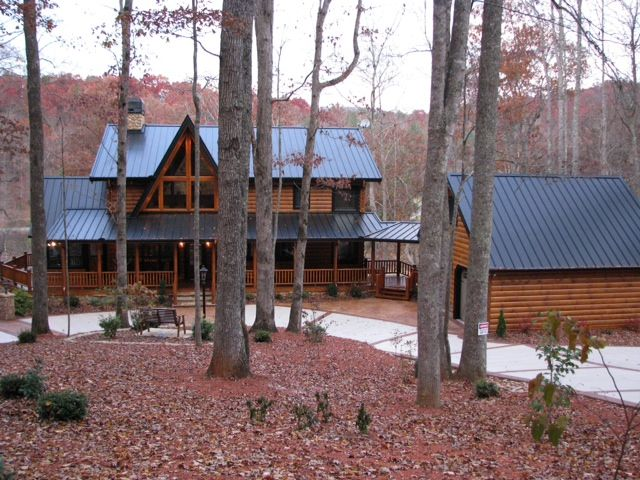 The wildcat trail 2 story custom log home plan breezeway for House plans with detached garage and breezeway