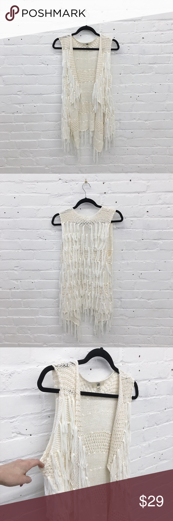 "Shaggy Fringe Vest Awesome shaggy fringe vest made of super soft stretchy knit. Looks festive-ready with cutoffs and booties!  🔹one size  🔹new without tags  🔹 31"" length   👉🏼 Willing to negotiate with serious buyers via the offer button!  👉🏼 Bundle with one more item for an instant 20% off! 👉🏼 Sorry, no try-ons or trades. Jackets & Coats Vests"