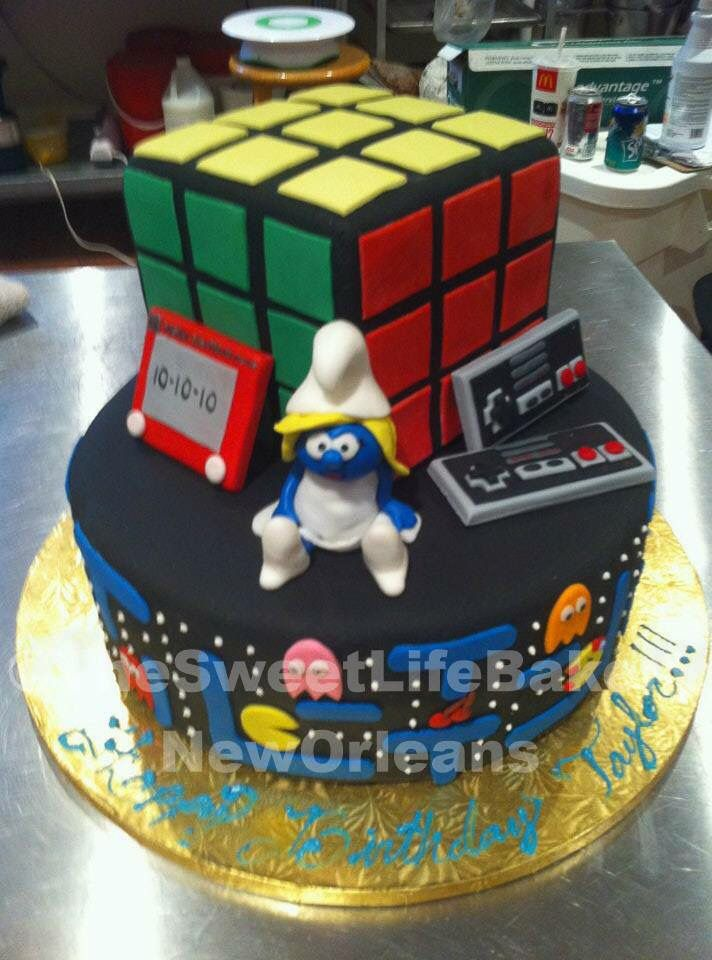 Smurf ,pac man, rubrik's cube themed Birthday cake by The Sweet Life Bakery New Orleans www.nolasweetlife.com email info@nolasweetlife.com (504)371-5153 #nolasweetlife @nolasweetlife