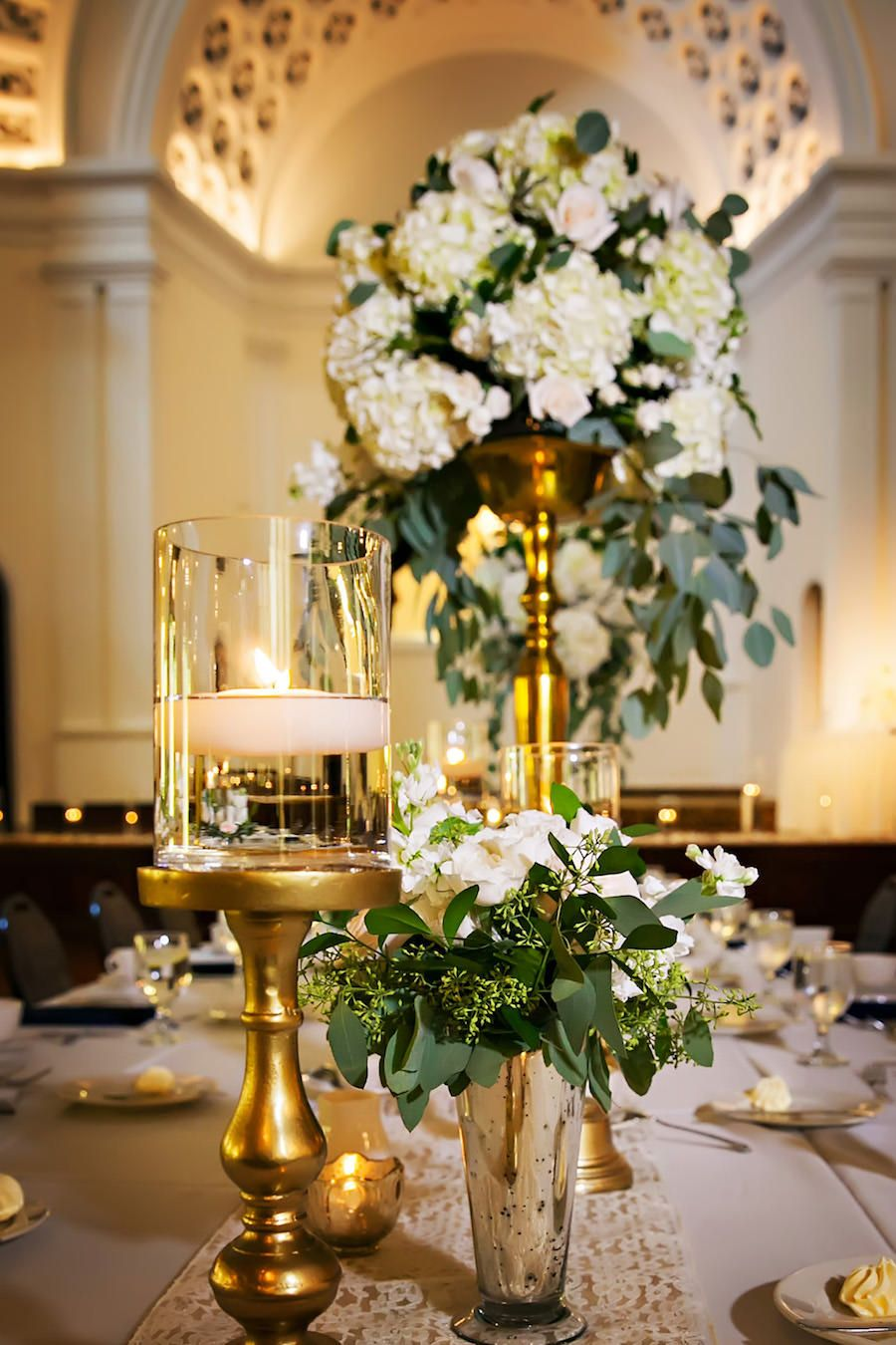 Elegant and traditional wedding reception décor with gold