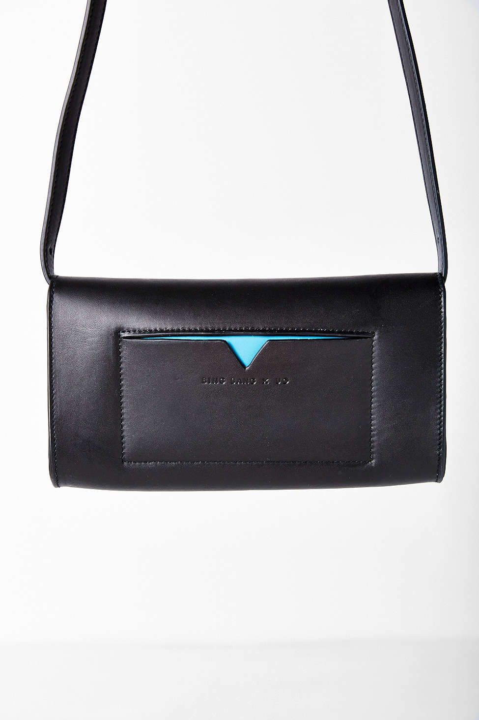 Bing Bang x UO Crossbody Bag - structured black leather with a pop of sky blue and luxe minimal gold hardware! So chic!