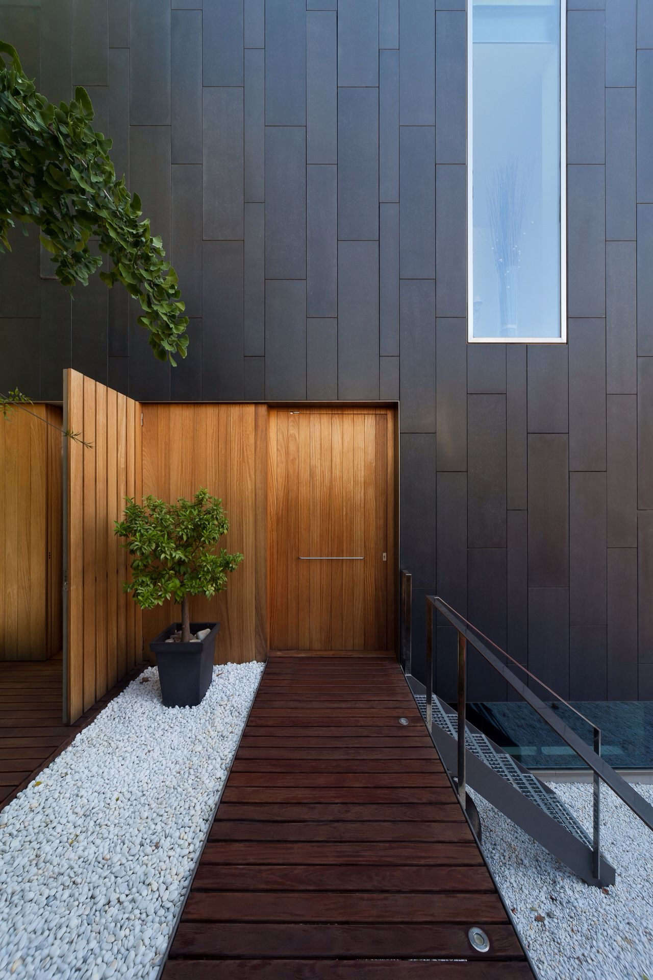 Cool grey house side paneling accented by the wood door fence and walkway & Cool grey house side paneling accented by the wood door fence and ...