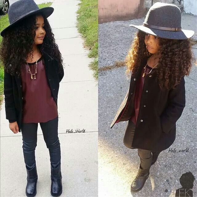 Beautiful little girl with long curly hair