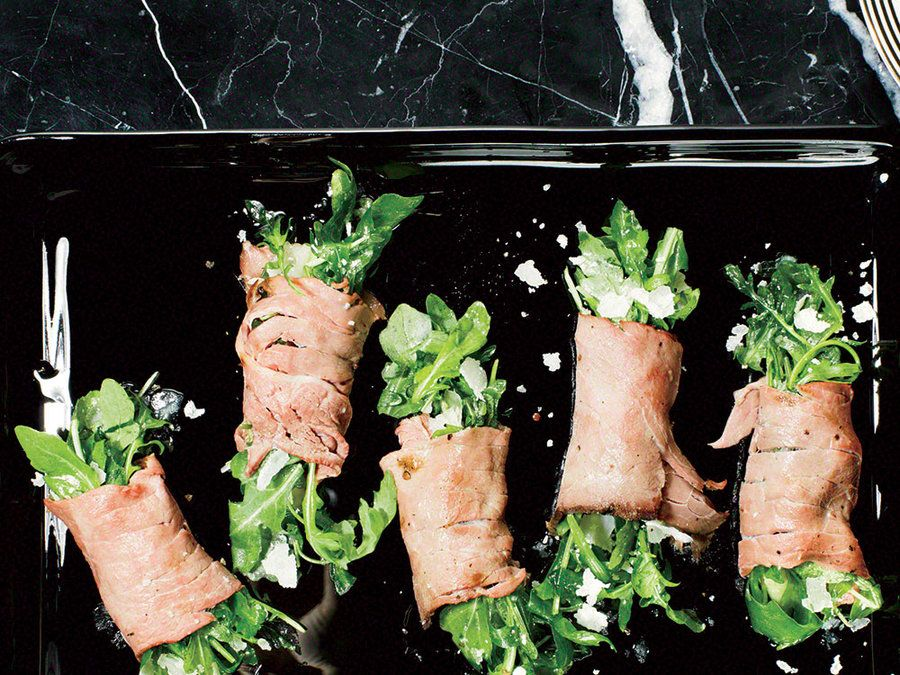Finely sliced roast beef bundles leafy arugula for an easy yet elegant appetizer.