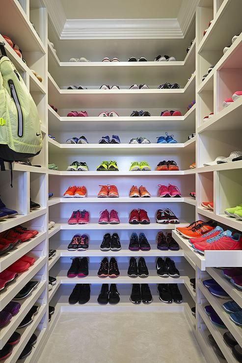 Walk In Workout Closet Features Floor To Ceiling Custom Shelves With Shoe  Cubbies Over Pull Out