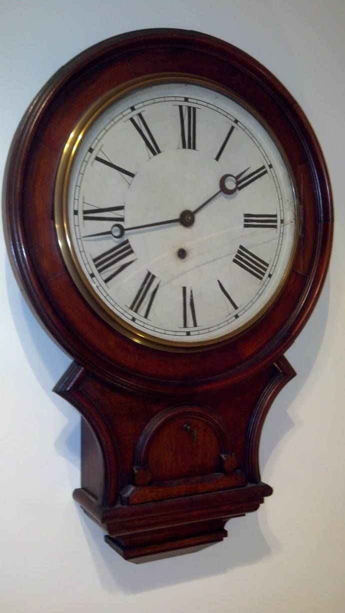 SOLD -- A walnut wall clock by Waterbury dating to around 1875 and measuring 25 inches high. I will be replacing the cracked glass and overhauling the movement. The wood case cannot be improved upon!