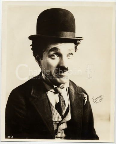 charlie chaplin as the little tramp donning one of the. Black Bedroom Furniture Sets. Home Design Ideas