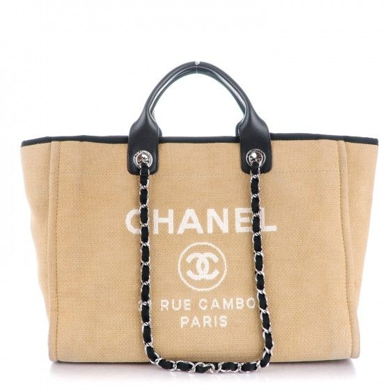 a5c5d6d42914 This is an authentic CHANEL Canvas Large Deauville Tote in Beige and Black.  This stylish tote is crafted of fine canvas with a white printed  advertisement ...