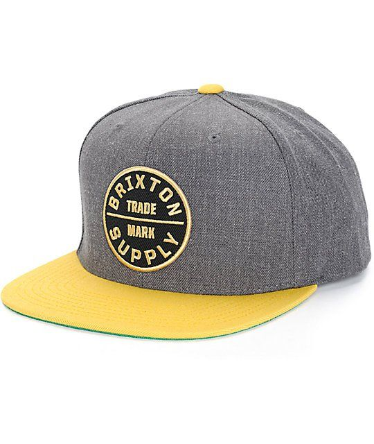 Snag a clean two tone street style for your hat collection with a Brixton  Supply logo patch on the front of a charcoal crown accented by a gold bill. e8808052da2