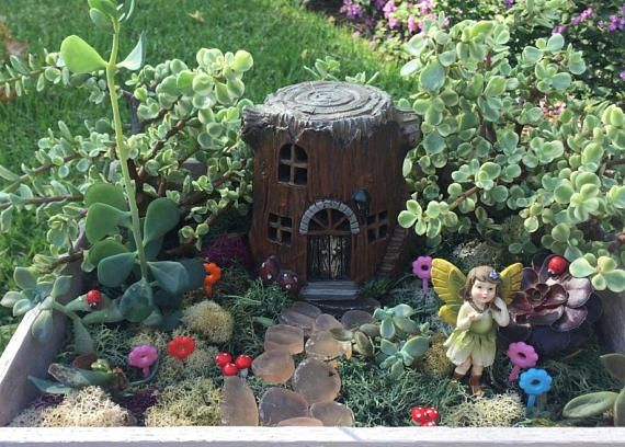 This DIY Enchanted Fairy Garden Kit Comes Complete With:   A Light Up Tree  Stump House (measures Approximately 4.5 Inches Tall And 4 Inches In  Diameter)   5 ...