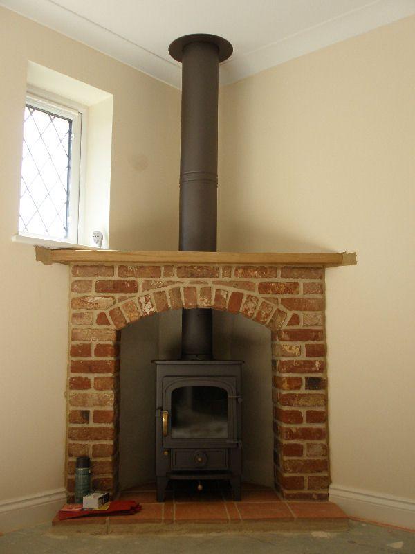 Fresco of simplify your indoor warming stuff with corner for Indoor corner fireplace