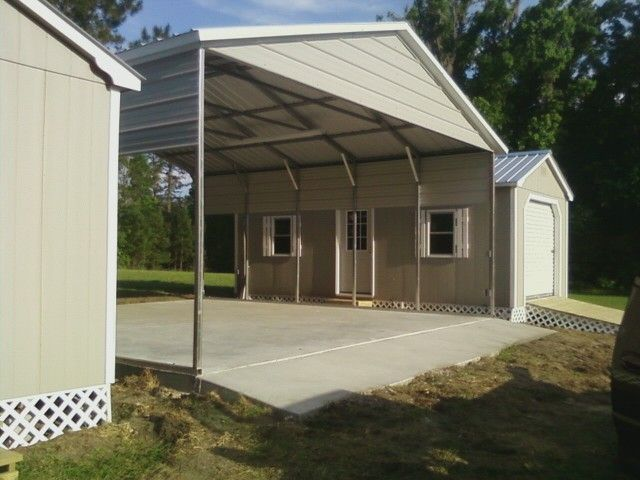 Two Wood Sheds And An A Frame Metal Carport Used To Create A Horse Stable
