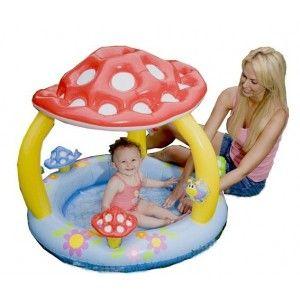 Super vrolijk babybadje met een grote paddenstoel als dakje, zodat uw kind uit de zon blijft. Met een afmeting van 102 x 89 cm, vervaardigd van vinyl.