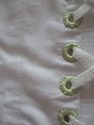 cover the eyelets grommets on a corset or on a laced