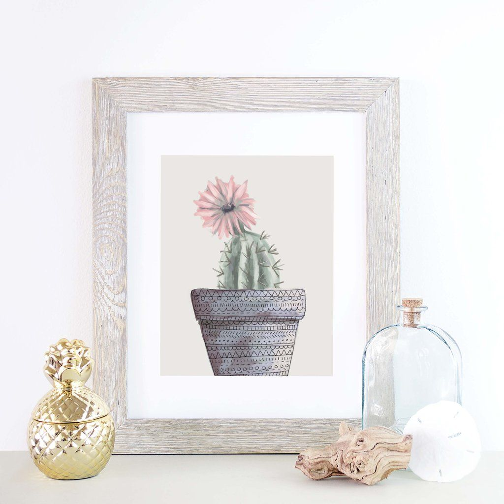 Bring style to your home decor or gallery wall with this art print. It features a hand painted succulent cactus in a gorgeous tribal pot set on a neutral beige background.