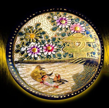 Beautiful Satsuma button with a pair of ducks and colourful flowers.