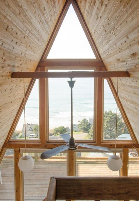 House in Tillamook, United States. A mid-century A-frame cabin, perched on a hillside just 2 blocks above Oceanside Village and the beach with panoramic ocean views. A quintessential Oregon get-away....quasi-rustic with all the right creature comforts.  The A-frame is a duplex, Uni...