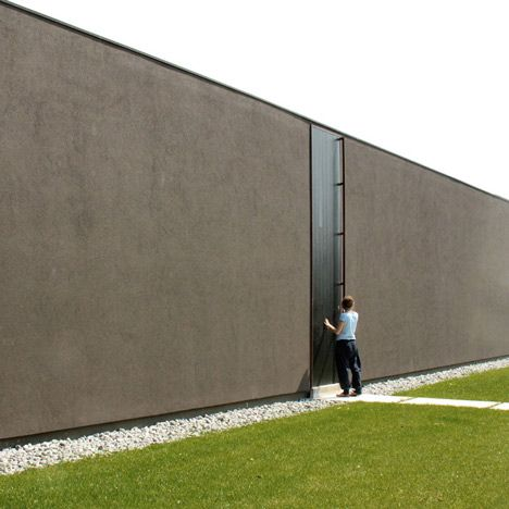 Nothing but a four metre-high door penetrates the plain facade of this house in  sc 1 st  Pinterest & Nothing but a four metre-high door penetrates the plain facade of ...