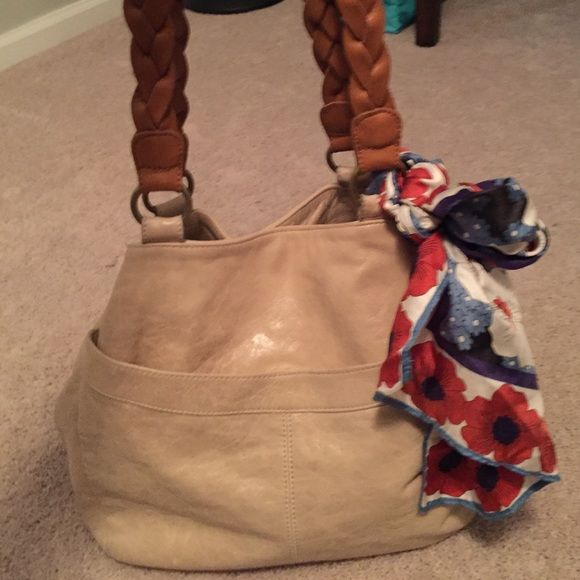 Anthropologie handbag Cute and comfortable cream with tan braided straps. Scarf is detachable! Used with a minor mark on the bottom Anthropologie Bags Shoulder Bags