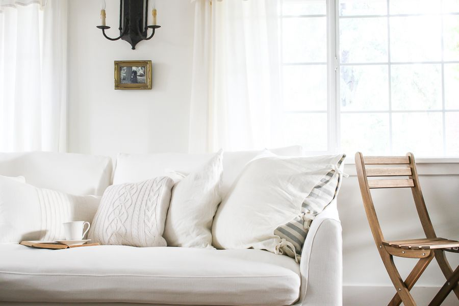Simple Cosy Living Room With A Shabby Chic Sofa In White Linen Rustic Country Style Living Room Blogger Sh Cosy Living Room Chic Sofa Shabby Chic Furniture