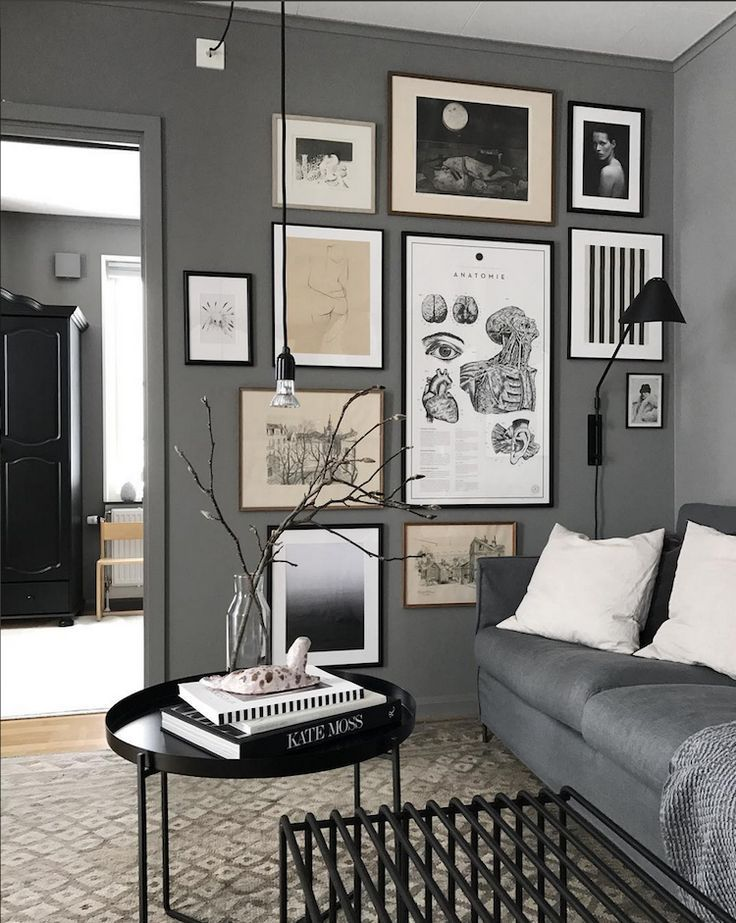 Casual Elegant Living Room: A Gallery Wall Against A Dark Grey Wall.
