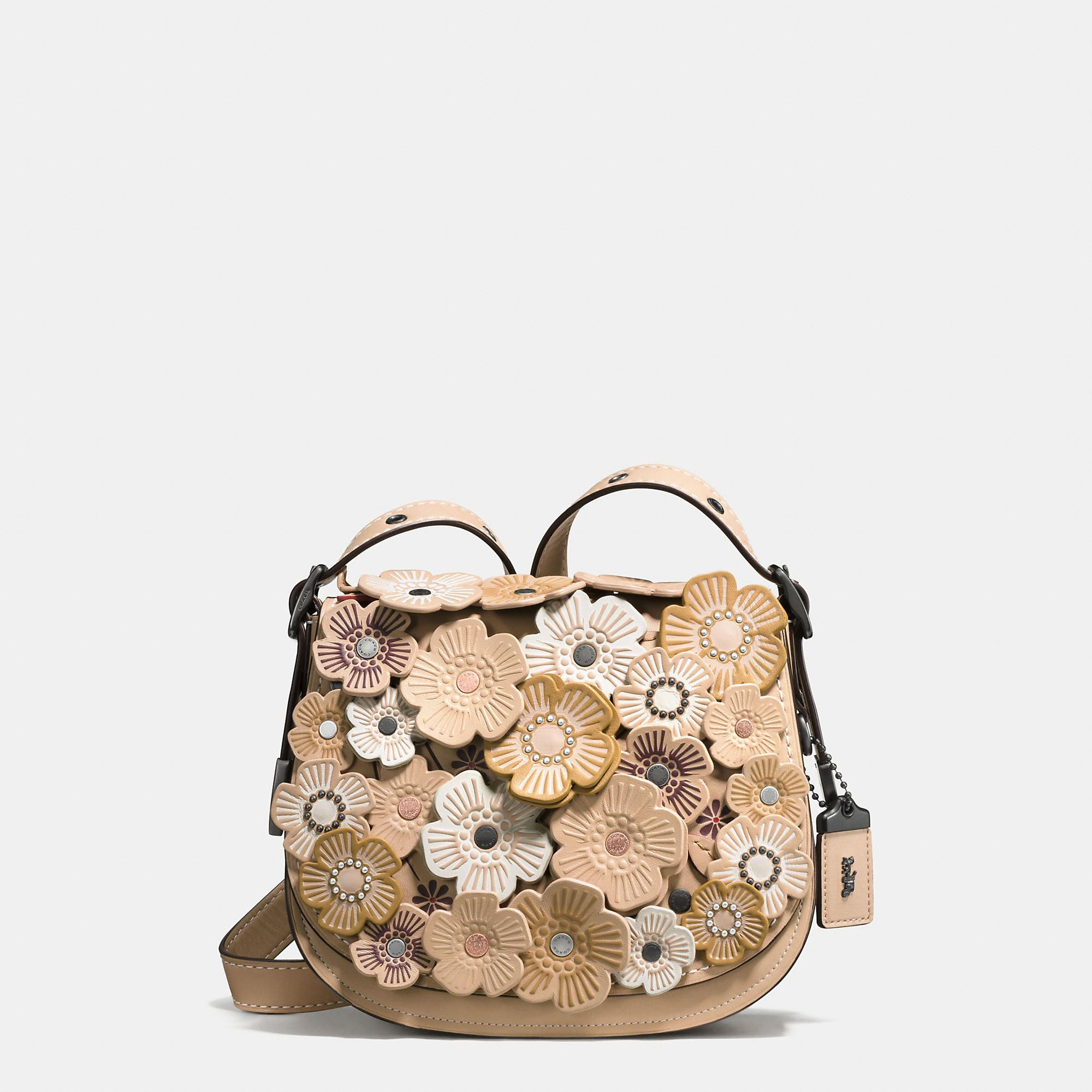 d9a34f6c76 Shop The COACH Tea Rose Applique Saddle Bag 23 In Leather. Enjoy  Complimentary Shipping   Returns! Find Designer Bags