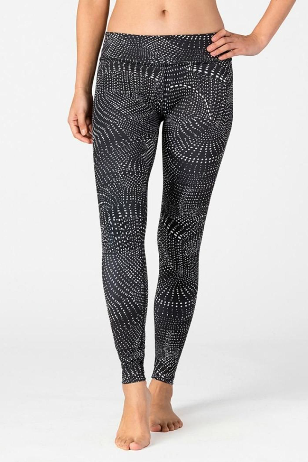 """We have you covered from head to toe in Beyond Yoga's Swirling Dots Legging. The unique pattern adds a fun twist to your usual workout attire. Similar to the ever-so-loved Essential Long Legging, the signature waistband and ankle length are perfect for all day wear. No outside seam. Ankle length. Supplex interior waistband 3"""" signature waistband.   Swirling Dots Leggings by Beyond Yoga. Clothing - Activewear Michigan"""
