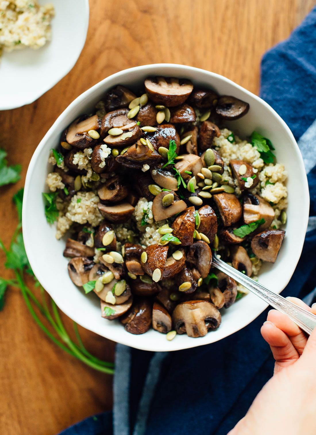 Delicious side dish or light meal of roasted mushrooms on herbed quinoa, topped with toasted pepitas and olive oil! This is a healthy vegetarian recipe.