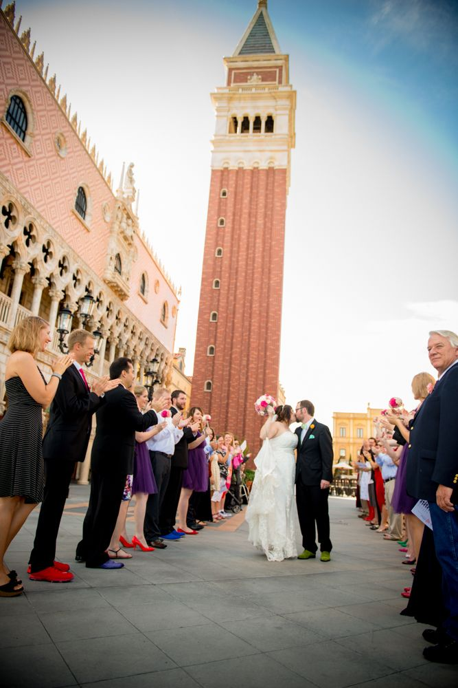An exit kiss following a beautiful ceremony in the Italy Plaza in Epcot