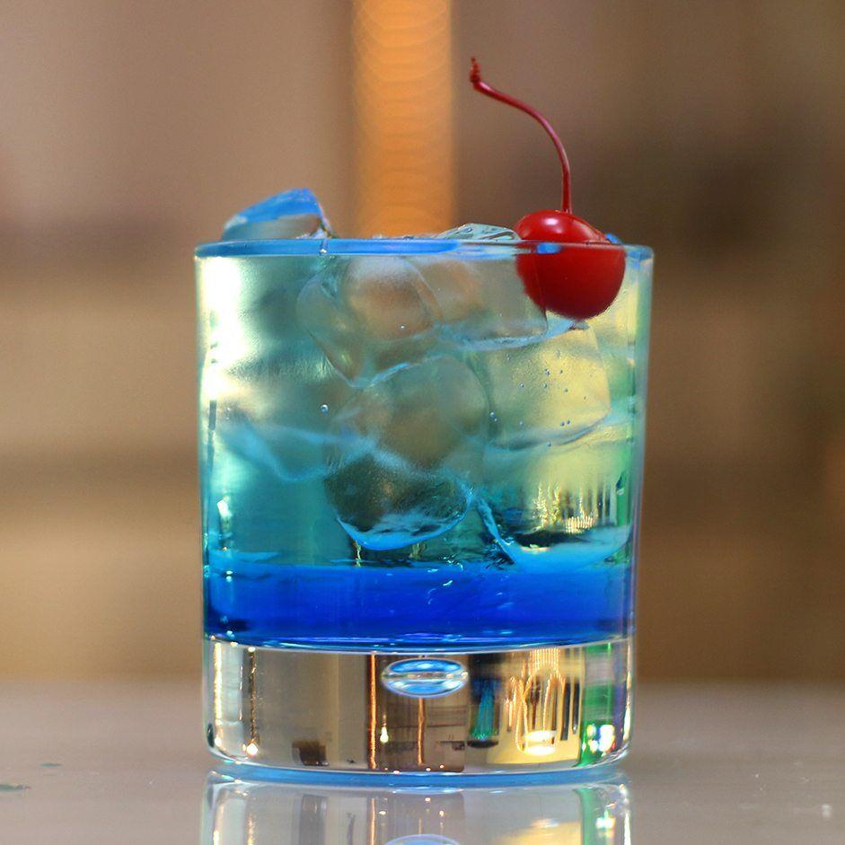 Spiked Ocean Water Tipsy Bartender Recipe Drink Garnishing Coconut Rum Blue Curacao