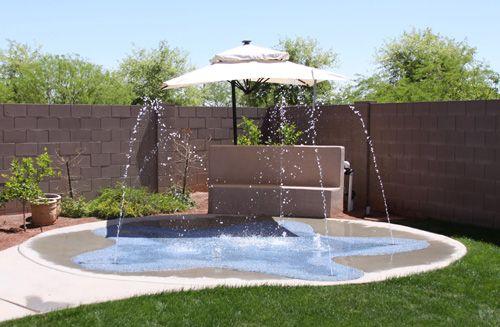 Backyard Splash Pads splash pads arizona | turning your space into a fun splash zone