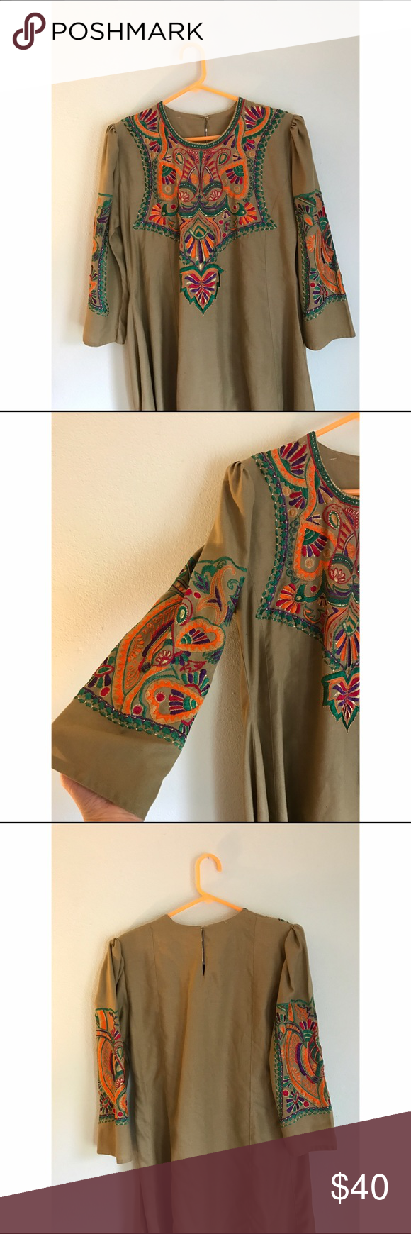 """Omersons Embroidered Dress Gorgeous vintage embroidered dress! No size on tag, 43"""" long, bust laid flat is 18"""", width is 23"""". Sleeves are 19"""". Original tag on clothing (no price shown). There are shoulder pads and a keyhole clasp in back. No flaws! Omersons Dresses Midi"""