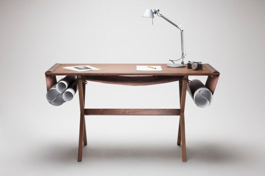 Oscar Desk by Giorgio Bonaguro Andrea Basile  The Oscar Desk by Giorgio Bonaguro for Valsecchi 1918 is an Architects dream table. Made from solid wood and soft leather, the stylish and versatile work desk is inspired by architects drawing boards(the desk takes its name from Oscar Niemeyer), and features three storage spaces created by suspended soft leather curves of different widths, for keeping drawings, notes, journals or, for the less traditionalists, their tablet.