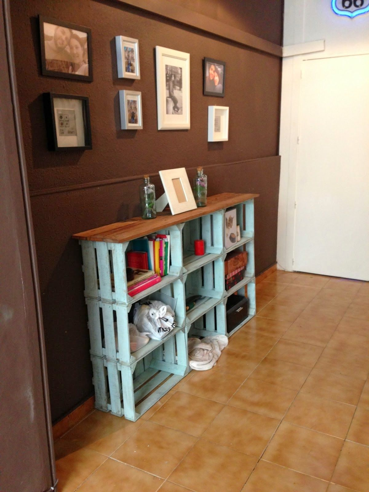 DIY - Paint crates and top off with wood plank. Great for storage! Could