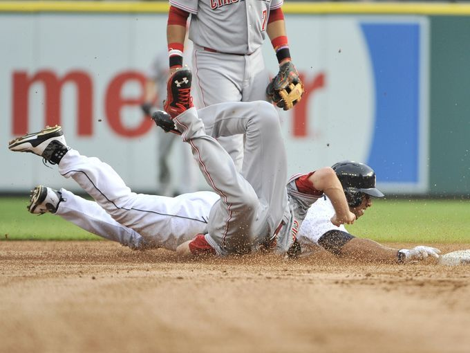 Reds pitcher Jon Moscot is injured on this play tagging
