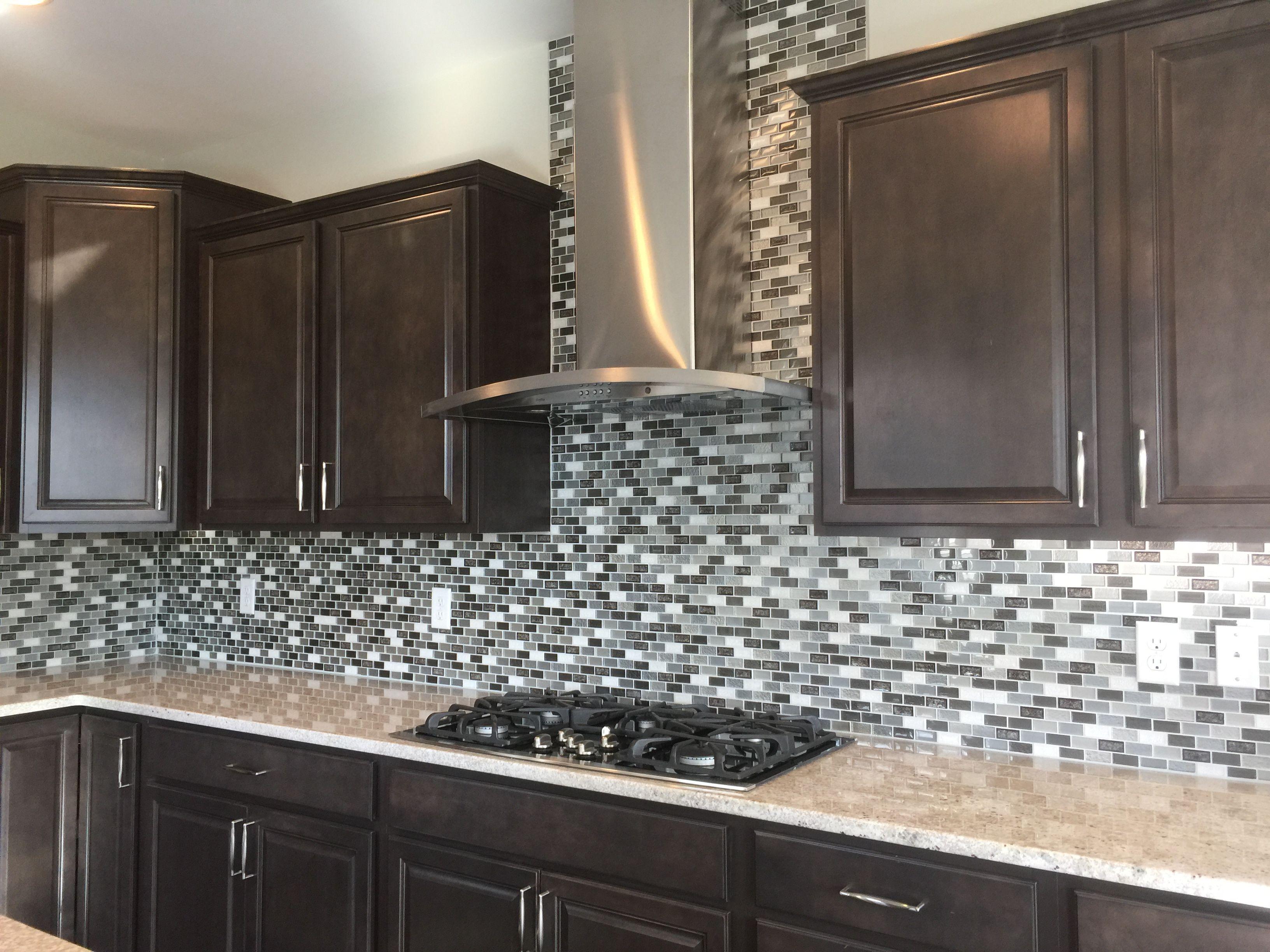 Crystal Shores Emerald Isle Backsplash Tile Dark Brown Kitchen Cabinets Brown Kitchen Cabinets Kitchen Ideas New House