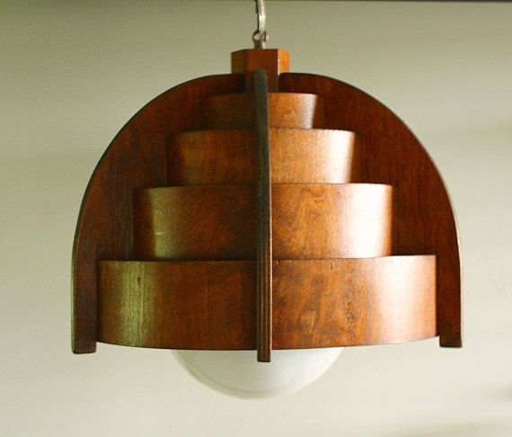 A Teak Hanging Lamp With A Large Milk Glass Light Diffusing Globe.