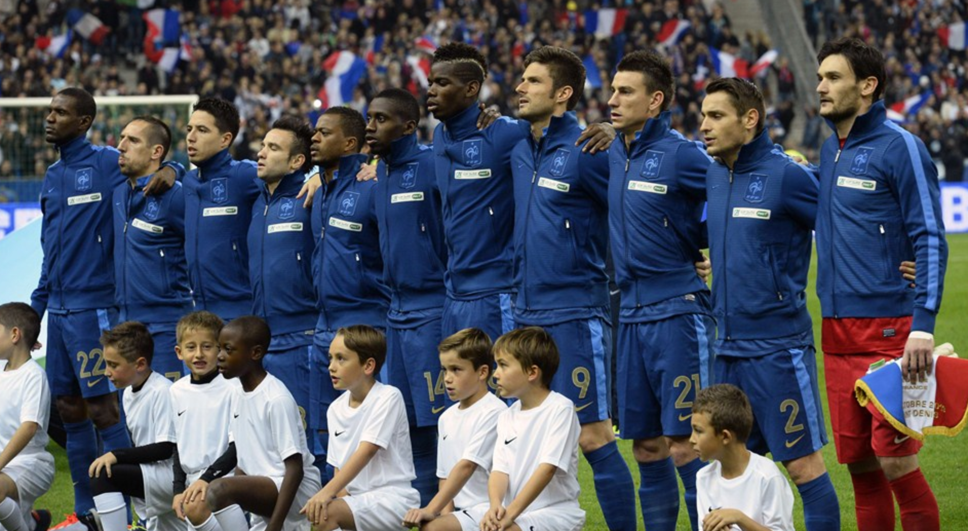 France's national football players listen to their