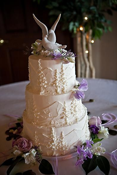 mountain wedding cake - obviously without the purple flowers and strange birds on top ;)