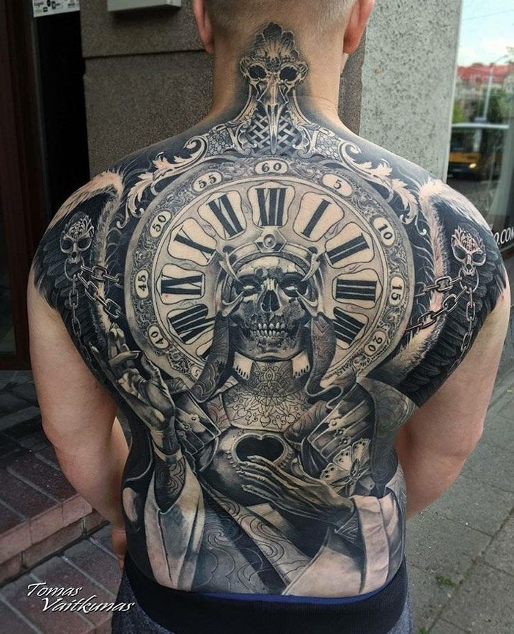 f09978bc16b94 Clock and skull full back tattoo, done in black & grey by Tomas Vaitkunas,  an artist based in Vilnius, Lithuania.