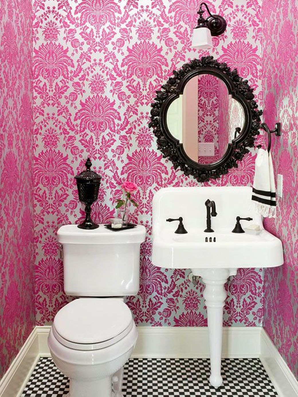 Bathroom , Small Bathroom Decorating Ideas : Great Small Bathroom Ideas  With Graphic Pink Wallpaper And Small Black Oval Ornate Mirror Over  Pedestal Sink