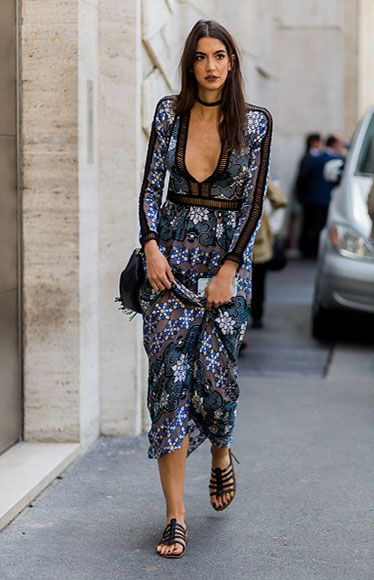 Here at Dressipi HQ, we are absolute die hard fans of LA based brand, For Love & Lemons. Pictured here on the streets of Milan in their 'Barcelona Maxi Dress', Sara Nicole Rossetto could not look more stunning if she tried. We love how she vamps up the dress with black nails, dark lips and a choker necklace. Photo: Christian Vierig