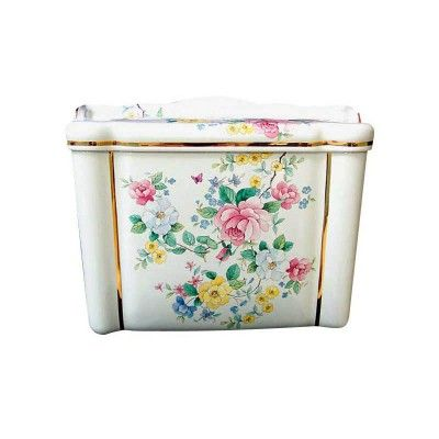 Hand painted Chintz design toilet with gold trim. Includes roses, buttercups, forget-me-nots and a butterfly and a ladybug. In delicate shades of pink, blue, yellow, white and green. By decoratedbathroom.