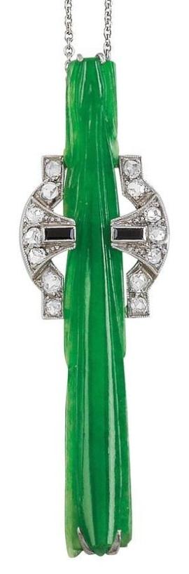 An Art Deco platinum, white gold and jade pendant necklace, circa 1930. #ArtDeco #pendant #necklace
