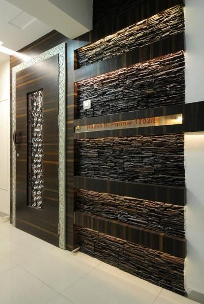 Custom wooden door with stone wall foyer designs for Main entrance door design