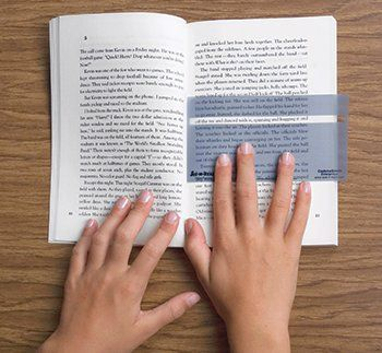 A great strategy to help a dyslexic child read is create a reading window out of cardboard that allows the child to only read one line at a time.  You can also use tinted cellophane paper to help cut down the drastic differences between the black and white print.