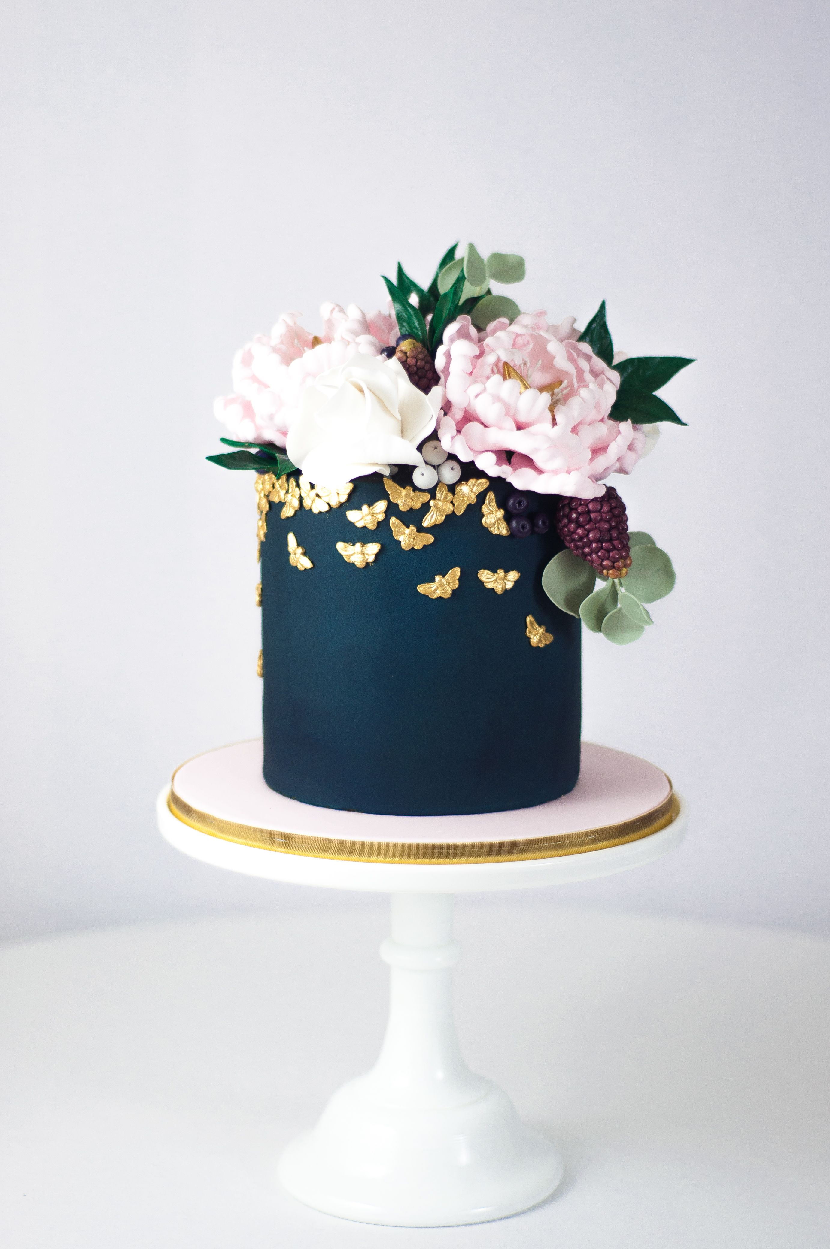 Navy blue wedding cake with blush sugar