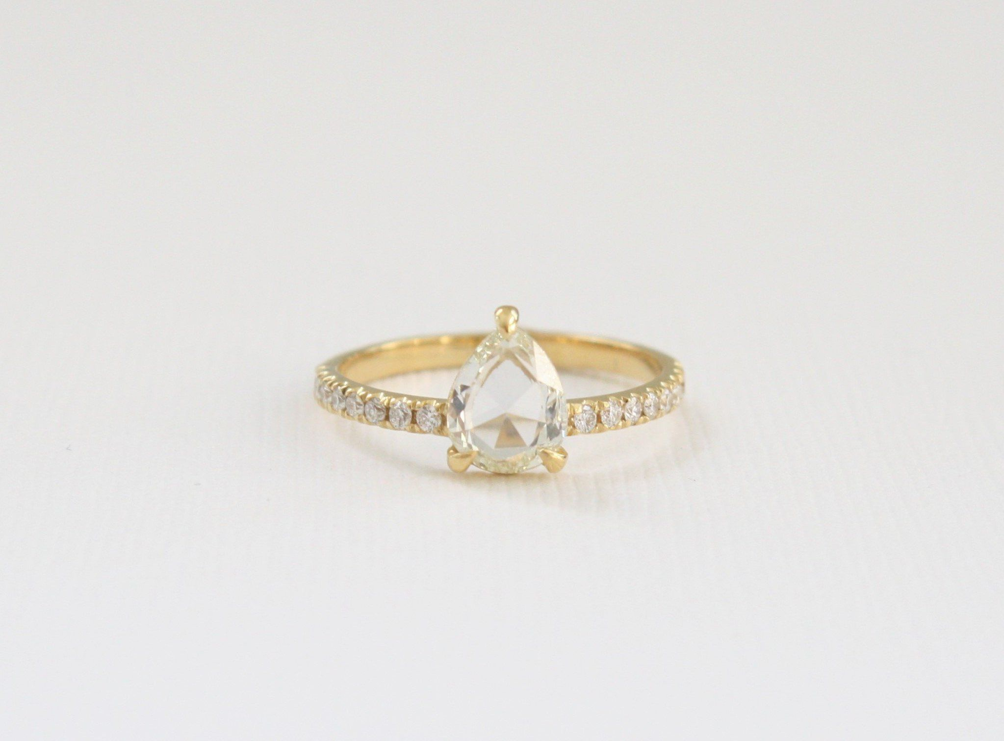 Rose cut pear shaped diamond solitaire ring in k yellow gold