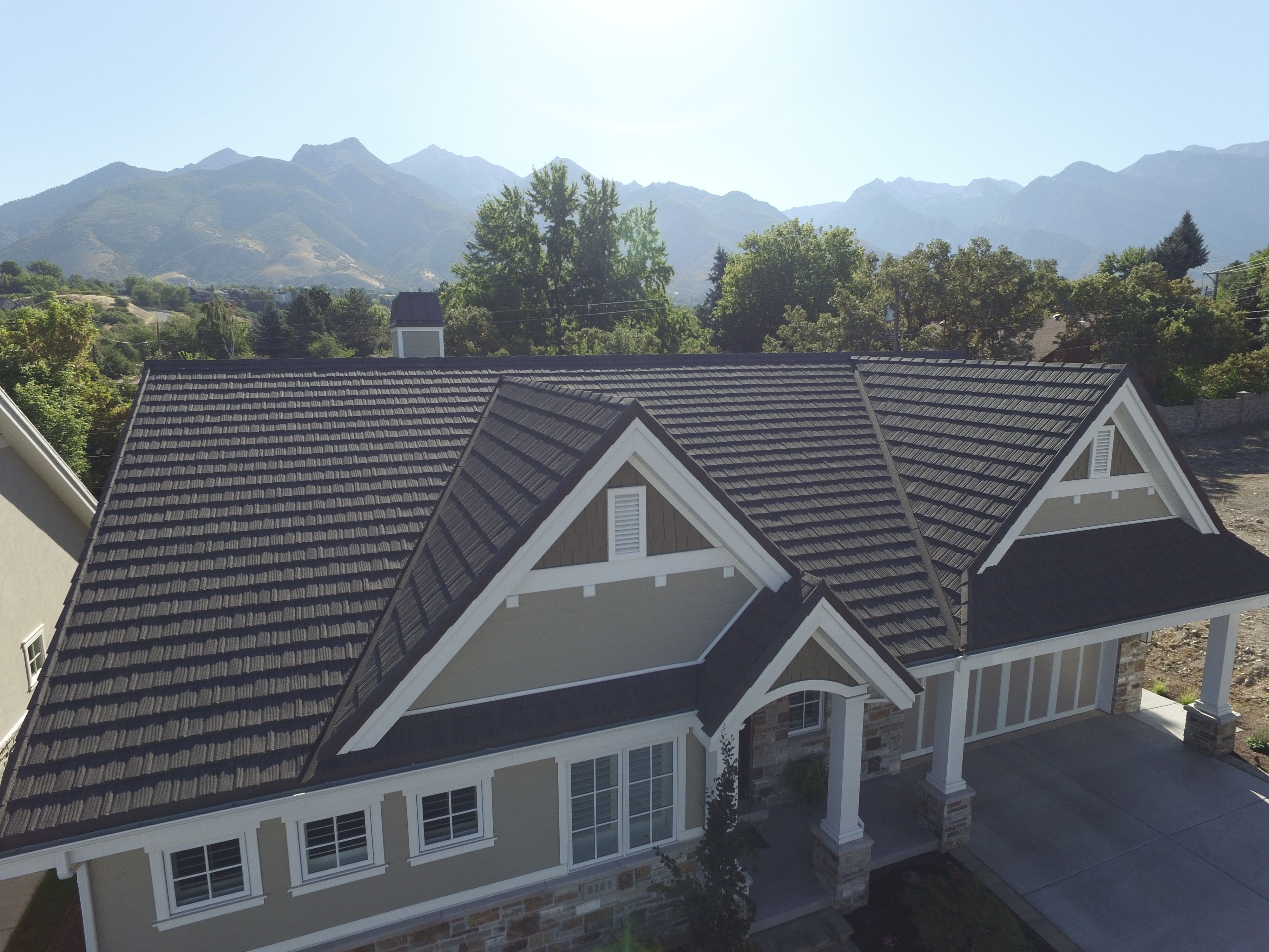 These Homeowners Decided To Put A Gerard Roof On Their Custom Built Home Not Only Did It Add To The Beauty Metal Roof Metal Roof Tiles Metal Roof Installation